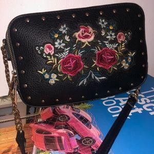 Black floral leather cross body bag